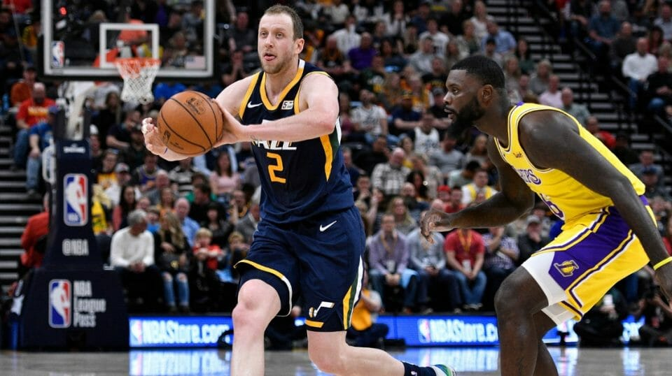 Joe Ingles of the Utah Jazz looks to pass the ball while being defended by Lance Stephenson of the Los Angeles Lakers on March 27, 2019, in Salt Lake City.