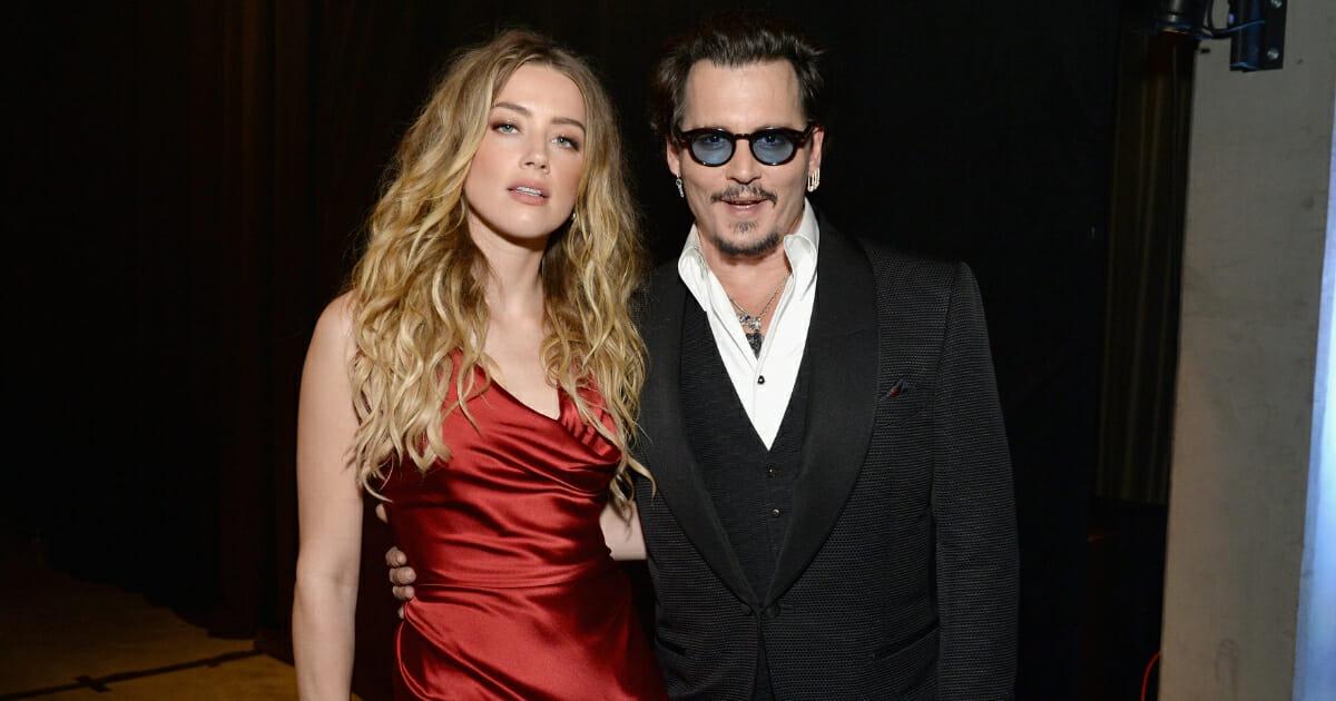 Actors Amber Heard and Johnny Depp attend The Art of Elysium 2016 HEAVEN Gala.