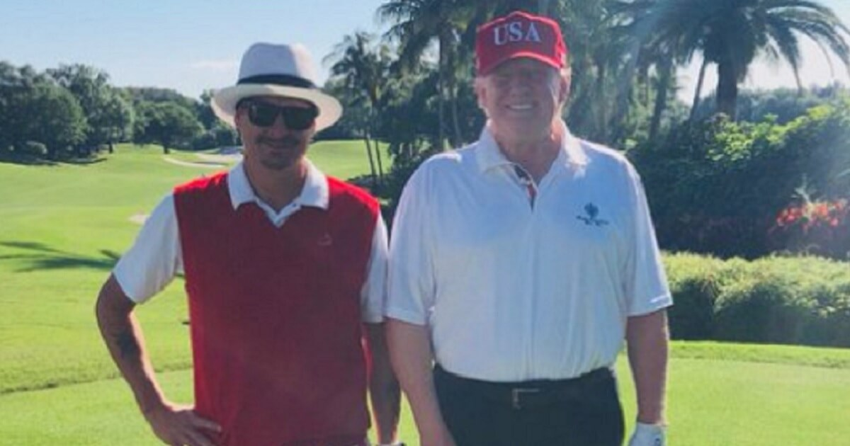Rapper Kid Rock, left, and President Donald Trump, right, post for a golf course picture.