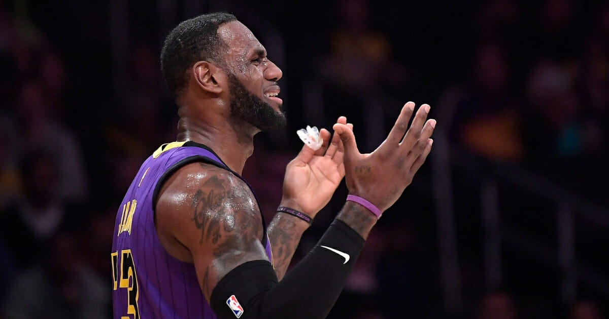 Los Angeles Lakers forward LeBron James reacts after being called for a foul during a game against the Brooklyn Nets on March 22, 2019, in Los Angeles.