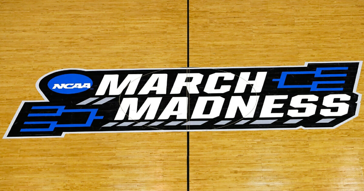 The NCAA's March Madness logo is seen on the court at Colonial Life Arena in Columbia, South Carolina on March 22, 2019.