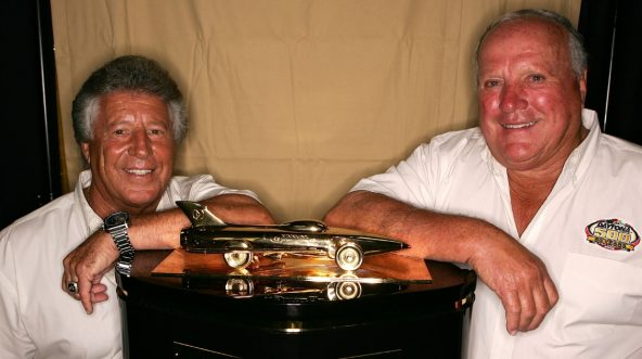 Daytona 500 winners, Mario Andretti (L) and A.J. Foyt, pose prior to practice for the NASCAR Nextel Cup Series Pepsi 400 at Daytona International Speedway on July 5, 2007 in Daytona, Florida.