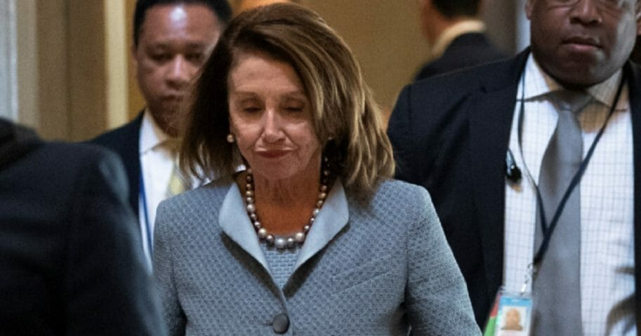 Nancy Pelosi frowning on Capitol Hill.