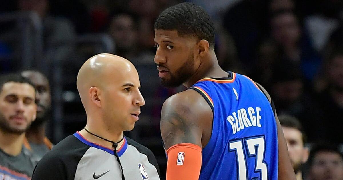 Oklahoma City Thunder forward Paul George looks at referee Aaron Smith