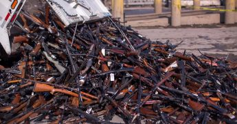 Thousands of guns slated for destruction are dumped from a truck outside a steel mill in Racho Cucamonga, California, in July 2018.
