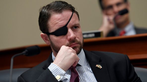 Rep. Dan Crenshaw, R-Texas, listens during a House Budget Committee hearing on Capitol Hill in Washington on March 12, 2019.