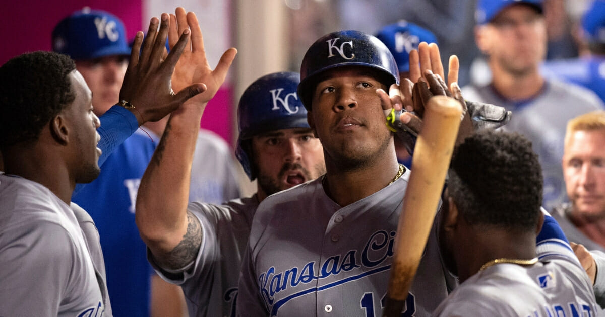 Kansas City Royals catcher Salvador Perez is welcomed in the dugout after scoring in a June 6, 2018, game against the Los Angeles Angels in Anaheim.