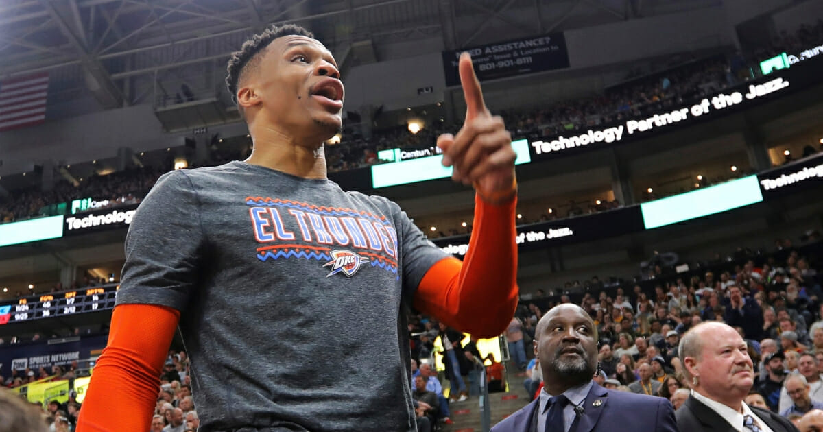 The Oklahoma City Thunder's Russell Westbrook gets into a heated verbal altercation with fans during a game against the Utah Jazz on March 11, 2019, in Salt Lake City.
