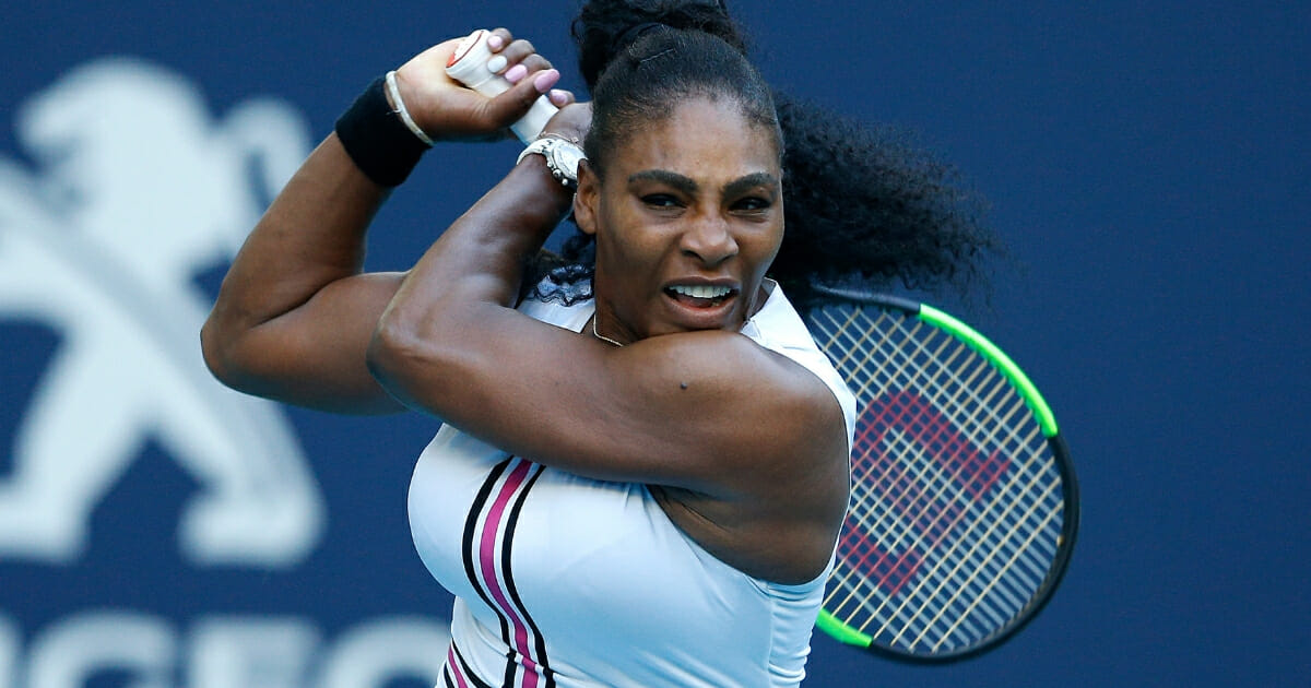 Serena Williams of the United States returns a shot to Rebecca Peterson of Sweden during Day 5 of the Miami Open Presented by Itau at Hard Rock Stadium on March 22, 2019 in Miami Gardens, Florida.