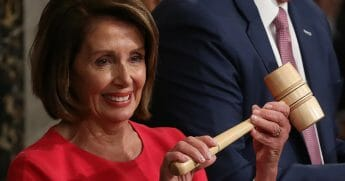 House Speaker Nancy Pelosi, D-Calif., holds up the gavel following her election as speaker.