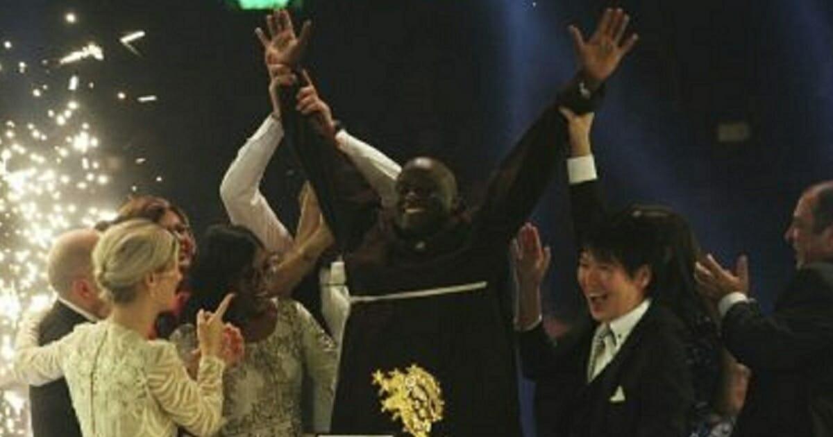 Kenyan teacher Peter Tabichi celebrates after winning the $1 million Global Teacher Prize in Dubai, United Arab Emirates, on Sunday.