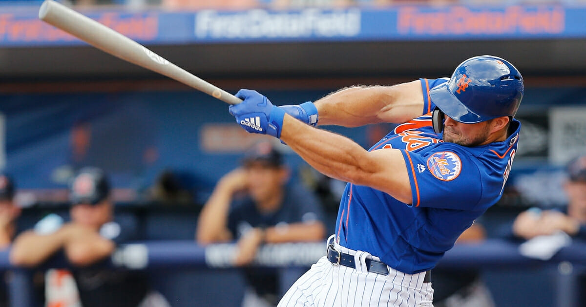 Tim Tebow of the New York Mets swings during a Grapefruit League spring training at-bat against the Atlanta Braves on Feb. 23, 2019, at First Data Field in Port St. Lucie, Florida.