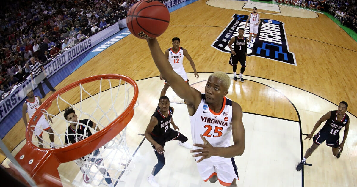 Mamadi Diakite #25 of the Virginia Cavaliers goes up for a dunk against the Gardner Webb Runnin Bulldogs during the first round of the 2019 NCAA Men's Basketball Tournament at Colonial Life Arena on March 22, 2019 in Columbia, South Carolina.