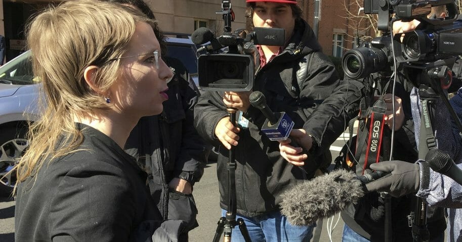 Chelsea Manning addresses the media outside federal court in Alexandria, Virginia.