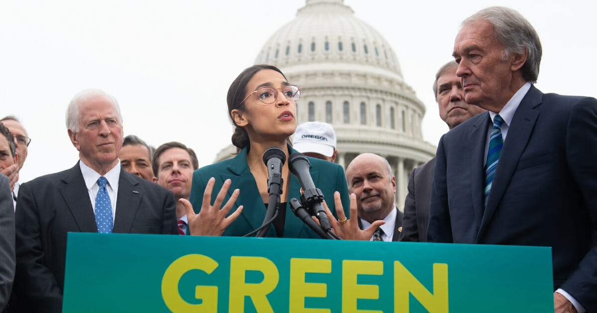 Rep. Alexandria Ocasio-Cortez, Democrat of New York, and U.S. Sen. Ed Markey, Democrat of Massachusetts, speak during a news conference to announce Green New Deal.