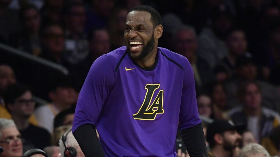 Los Angeles Lakers forward LeBron James laughs as he waits to check in to the team's NBA basketball game against the Charlotte Hornets during the second half Friday, March 29, 2019, in Los Angeles.