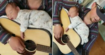 A tiny baby asleep on a guitar that her dad is playing.