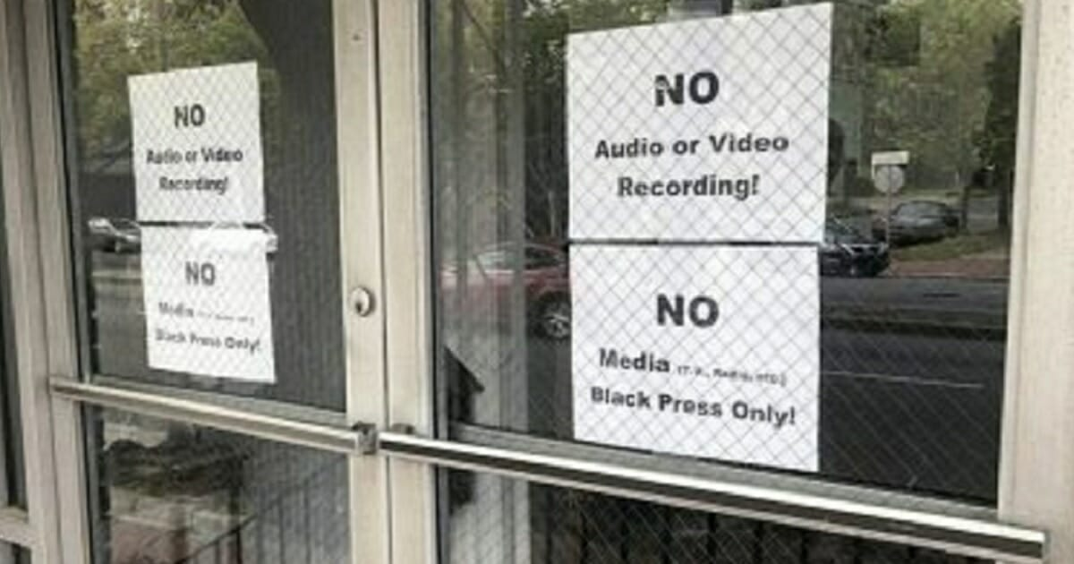 Signs posted on the doors of the Bolten Street Baptist Church in Savannah, Georgia, are seen during a meeting coordinated to garner support for one black candidate in the city's upcoming mayoral race.