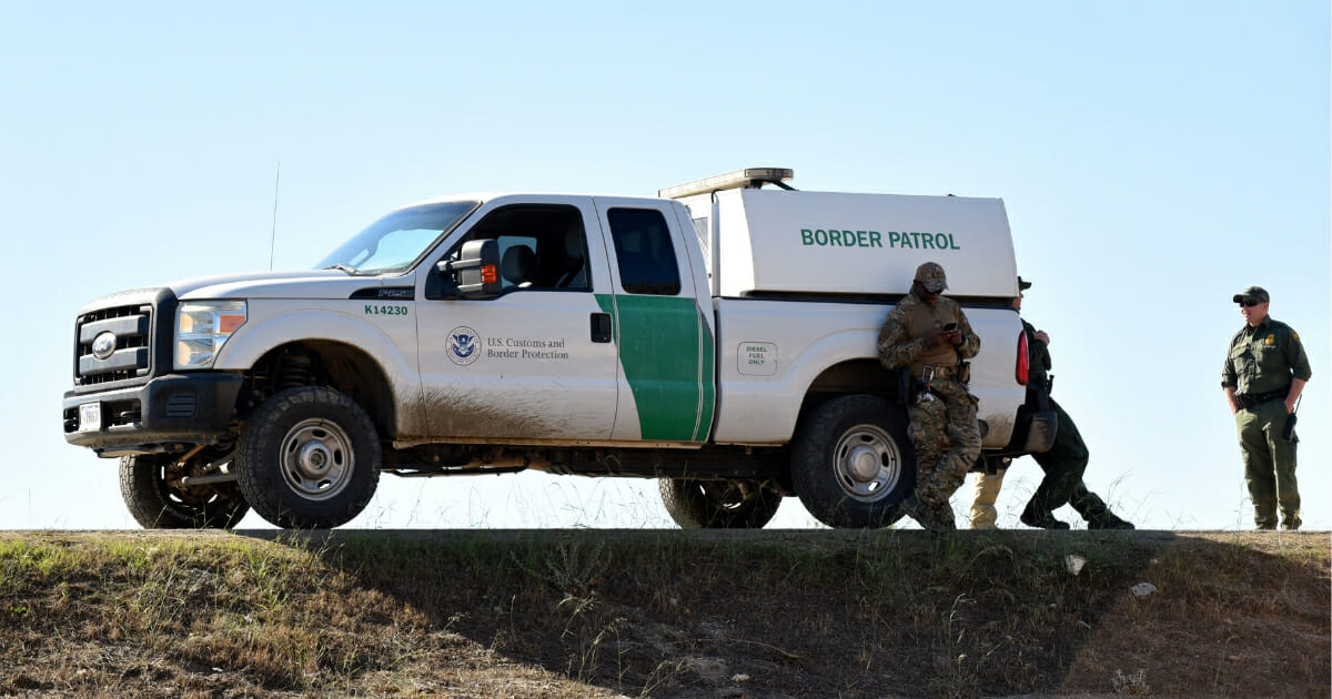 Borer Patrol agents on the border between the U.S. and Mexico.