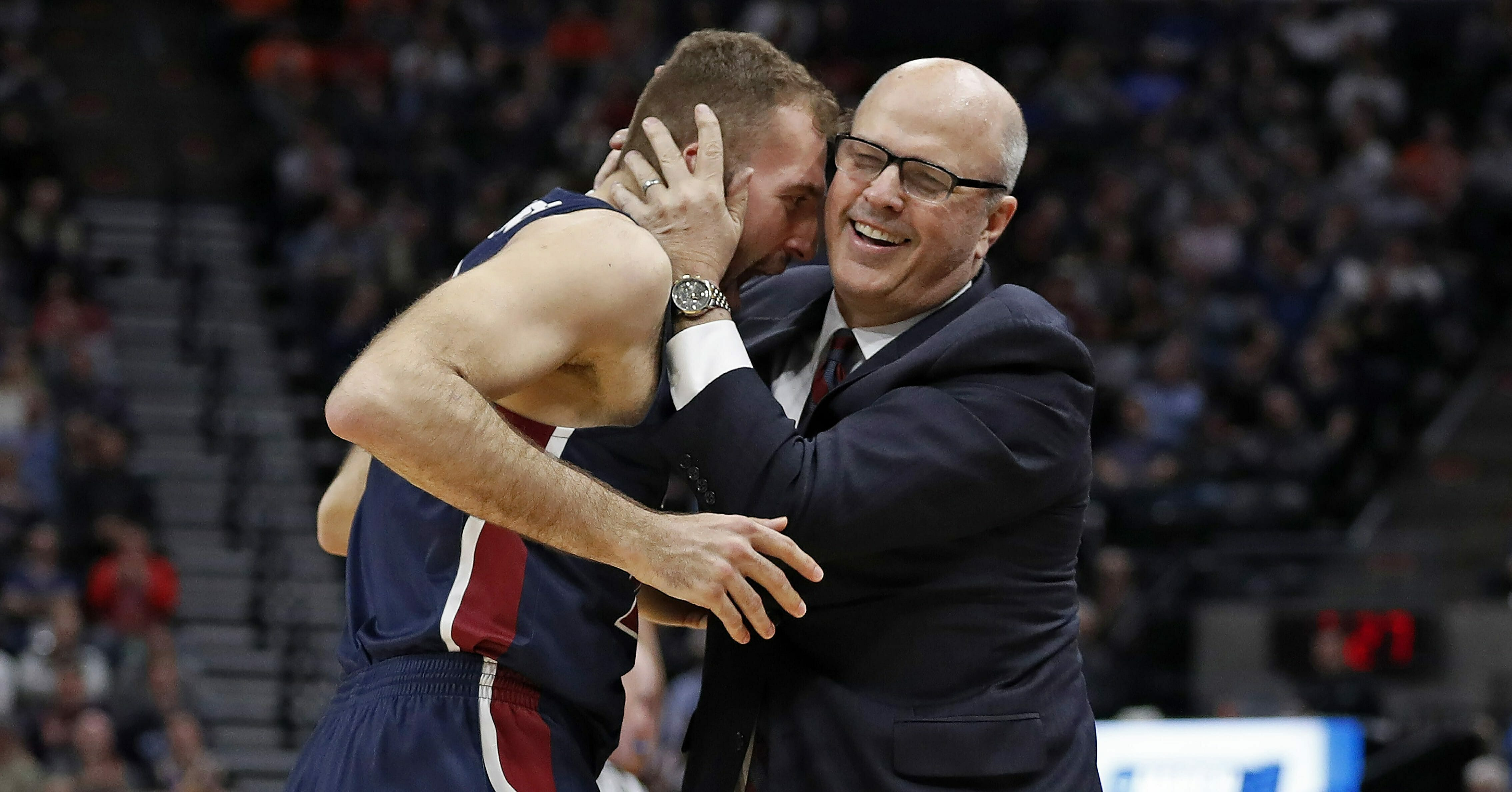 Fairleigh Dickinson forward Nadi Beciri, left, is embraced by coach Greg Herenda after a second-half shot against Gonzaga in the NCAA Tournament on March 21, 2019, in Salt Lake City.