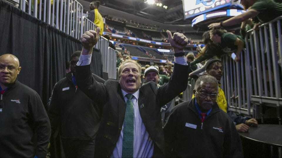 Michigan State head coach Tom Izzo celebrates as he comes off the court after an NCAA men's East Regional final college basketball game against Duke in Washington, Sunday, March 31, 2019.