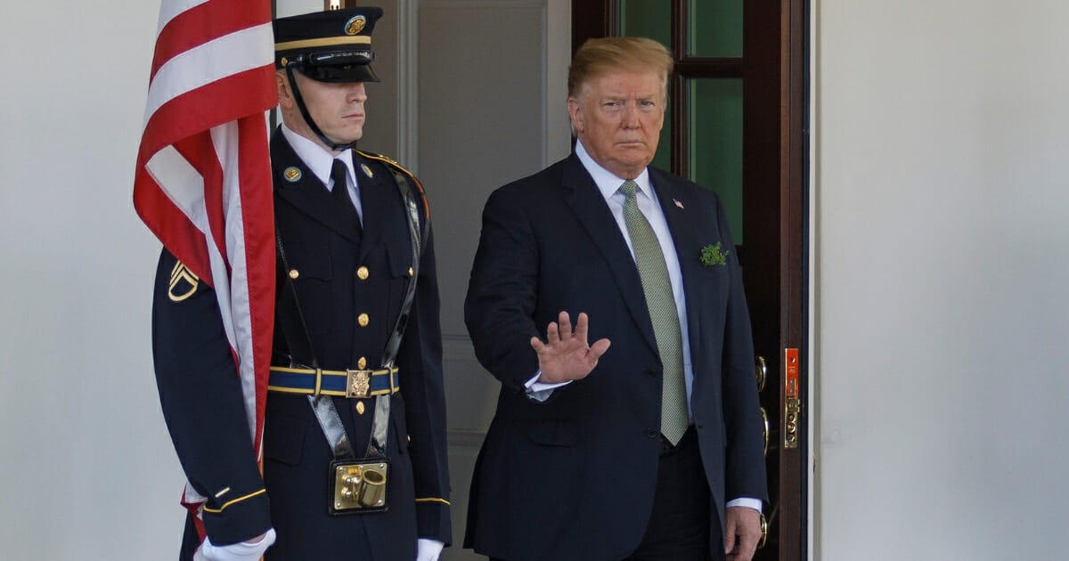 President Donald Trump waves to members of the media as Ireland Prime Minister Leo Varadkar arrives on March 14, 2019 in Washington, D.C.