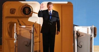 President Donald Trump waves after arriving at Noi Bai airport in Hanoi on Feb. 26, 2019.
