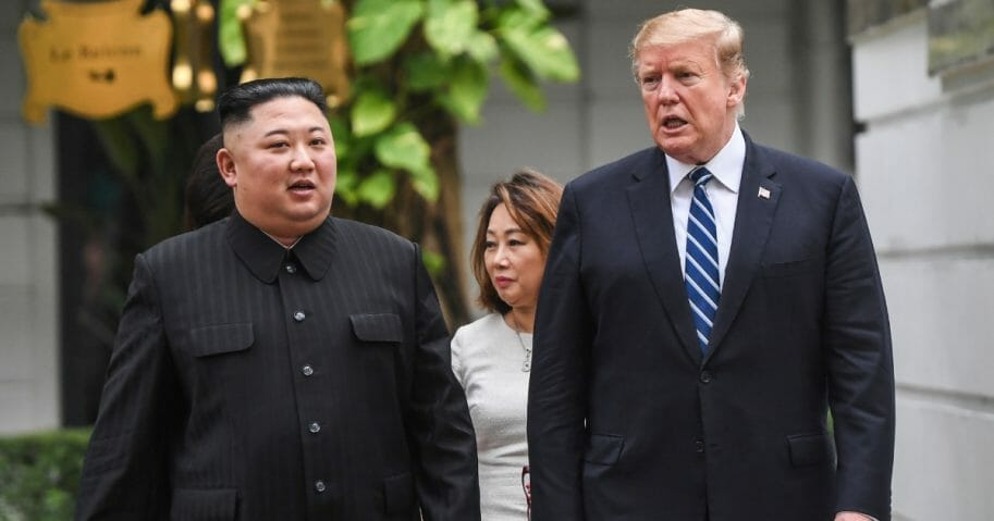 President Donald Trump (right) walks with North Korea's leader Kim Jong Un during a break in talks at the second U.S.-North Korea summit.