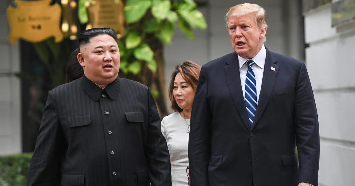 President Donald Trump (right) walks with North Korea's leader Kim Jong Un during a break in talks at the second U.S.-North Korea summit.