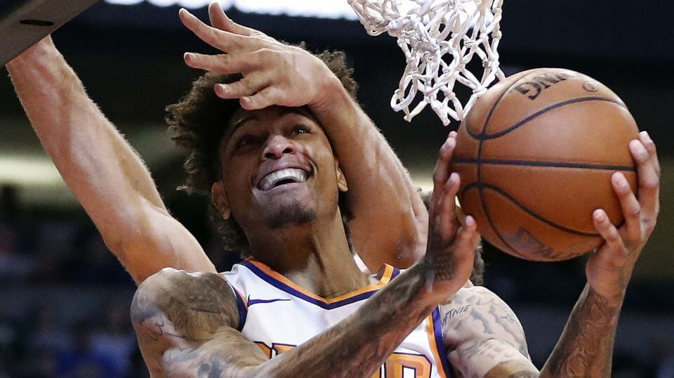 Phoenix Suns forward Kelly Oubre Jr. is fouled by Milwaukee Bucks center Brook Lopez during the second half of an NBA basketball game, Monday, March 4, 2019, in Phoenix
