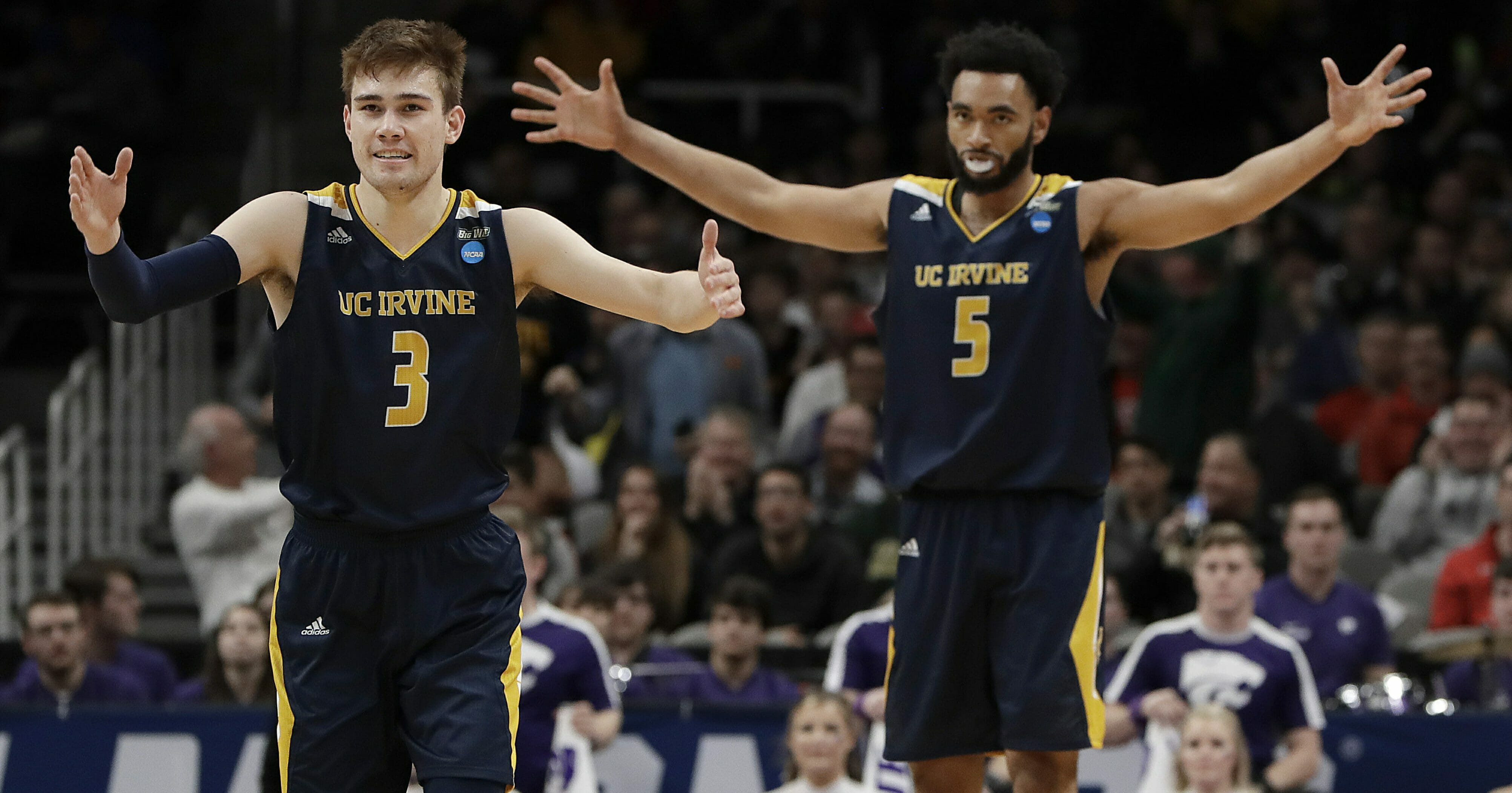 UC Irvine guard Robert Cartwright (3) and forward Jonathan Galloway (5) celebrate during the Anteaters' first-round upset of Kansas State