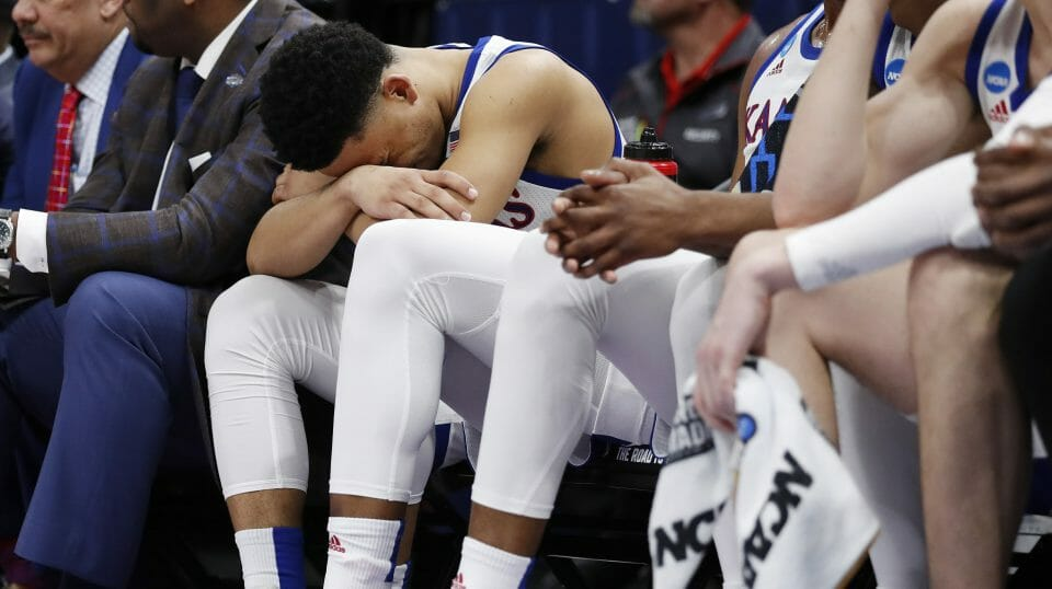 Kansas guard Devon Dotson sits on the bench in the closing minutes of the team's loss to Auburn in a second-round game in the NCAA men's college basketball tournament Saturday, Mar. 23, 2019, in Salt Lake City.