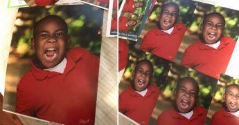Little boy makes face in school portraits.