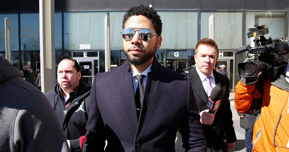 Actor Jussie Smollett leaves the Leighton Courthouse after his court appearance on March 26, 2019 in Chicago.