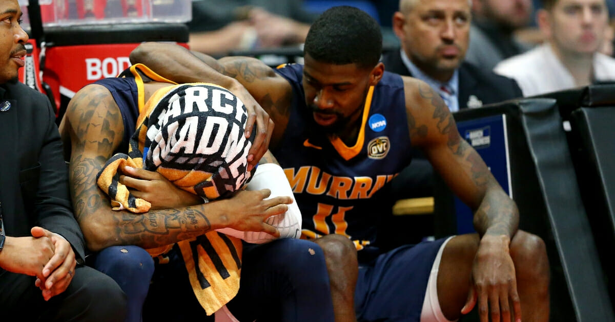 Ja Morant of the Murray State Racers is consoled by teammate Shaq Buchanan as he reacts late in the game of his team's loss to the Florida State Seminoles during the second round of the 2019 NCAA Men's Basketball Tournament at XL Center on Mar. 23, 2019 in Hartford, Connecticut.