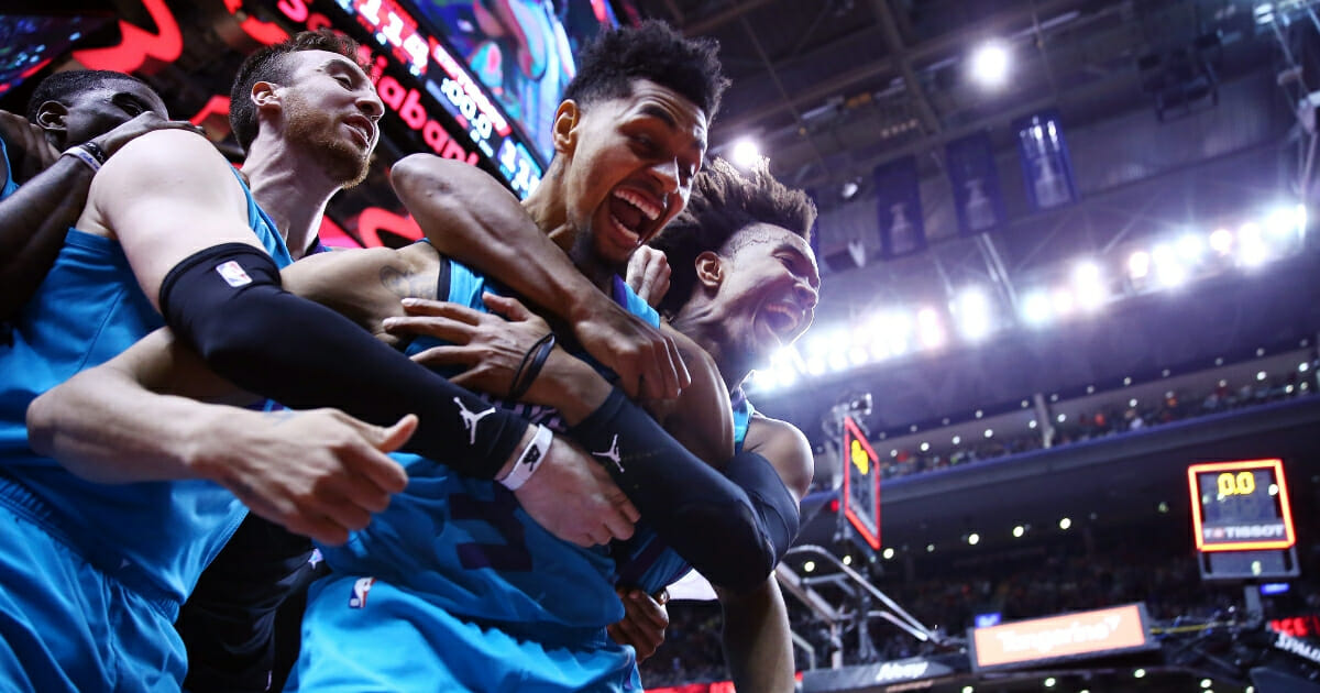 Jeremy Lamb of the Charlotte Hornets celebrates with teammates after sinking a buzzer beater to win an NBA game against the Toronto Raptors at Scotiabank Arena on Mar. 24, 2019 in Toronto.