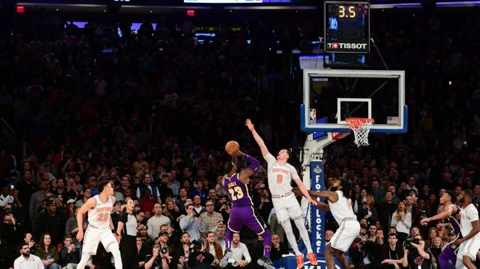 LeBron James of the Los Angeles Lakers attempts a basket but is blocked by Mario Hezonja of the New York Knicks in the last seconds of the game at Madison Square Garden on March 17, 2019 in New York City.