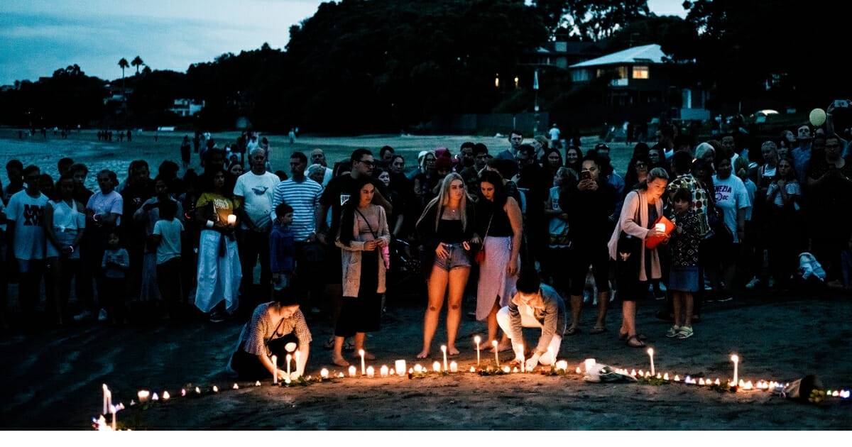 Crowds gather on Takapuna beach for a vigil in memory of the victims of the Christchurch mosque terror attacks on March 16, 2019.