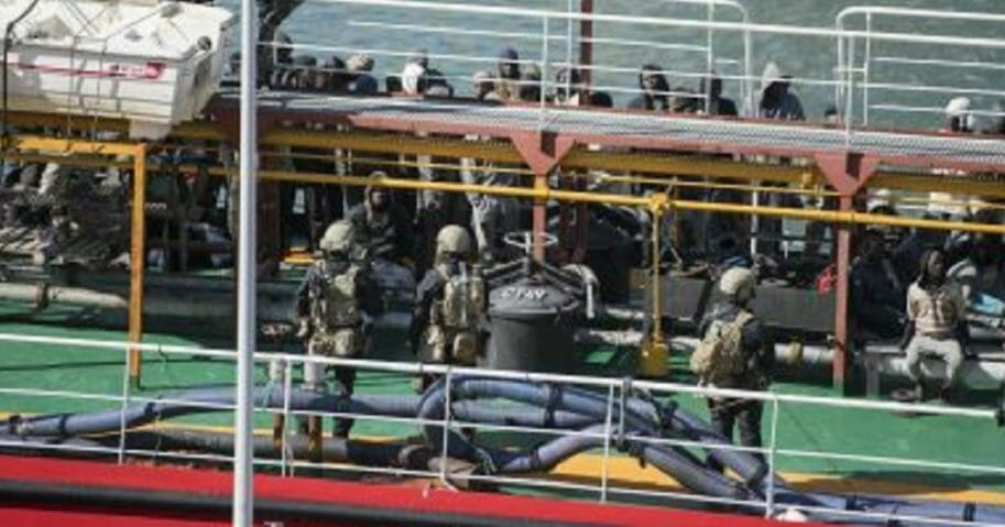 Armed forces stand aboard the Turkish oil tanker El Hiblu 1, which was hijacked by migrants, in Valletta, Malta, on Thursday.