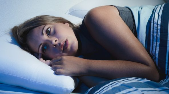 Young woman who is having trouble sleeping.