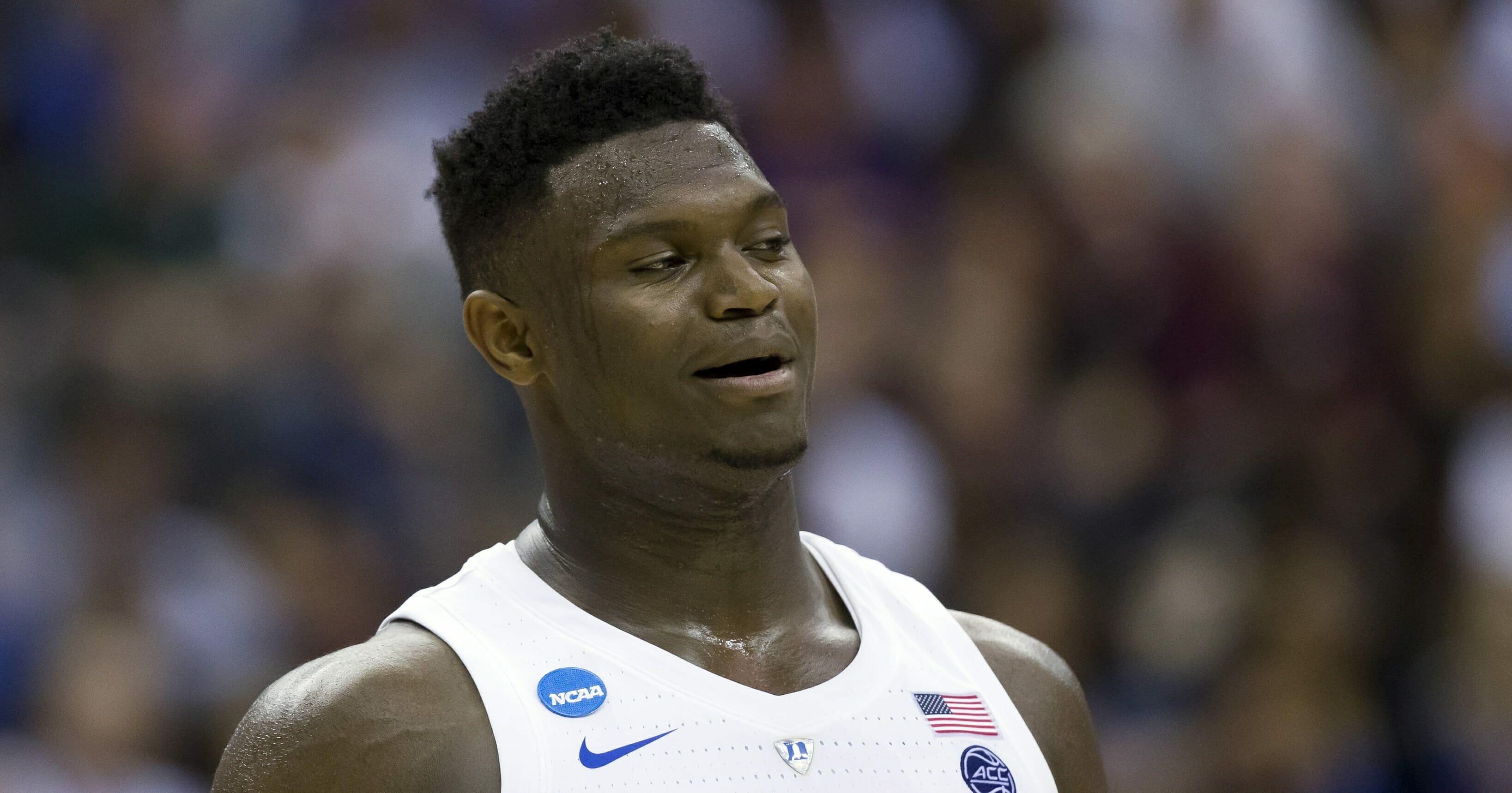 In this March 29, 2019, file photo, Duke forward Zion Williamson reacts during an East Regional semifinal in the NCAA men's basketball tournamenet against Virginia Tech in Washington.