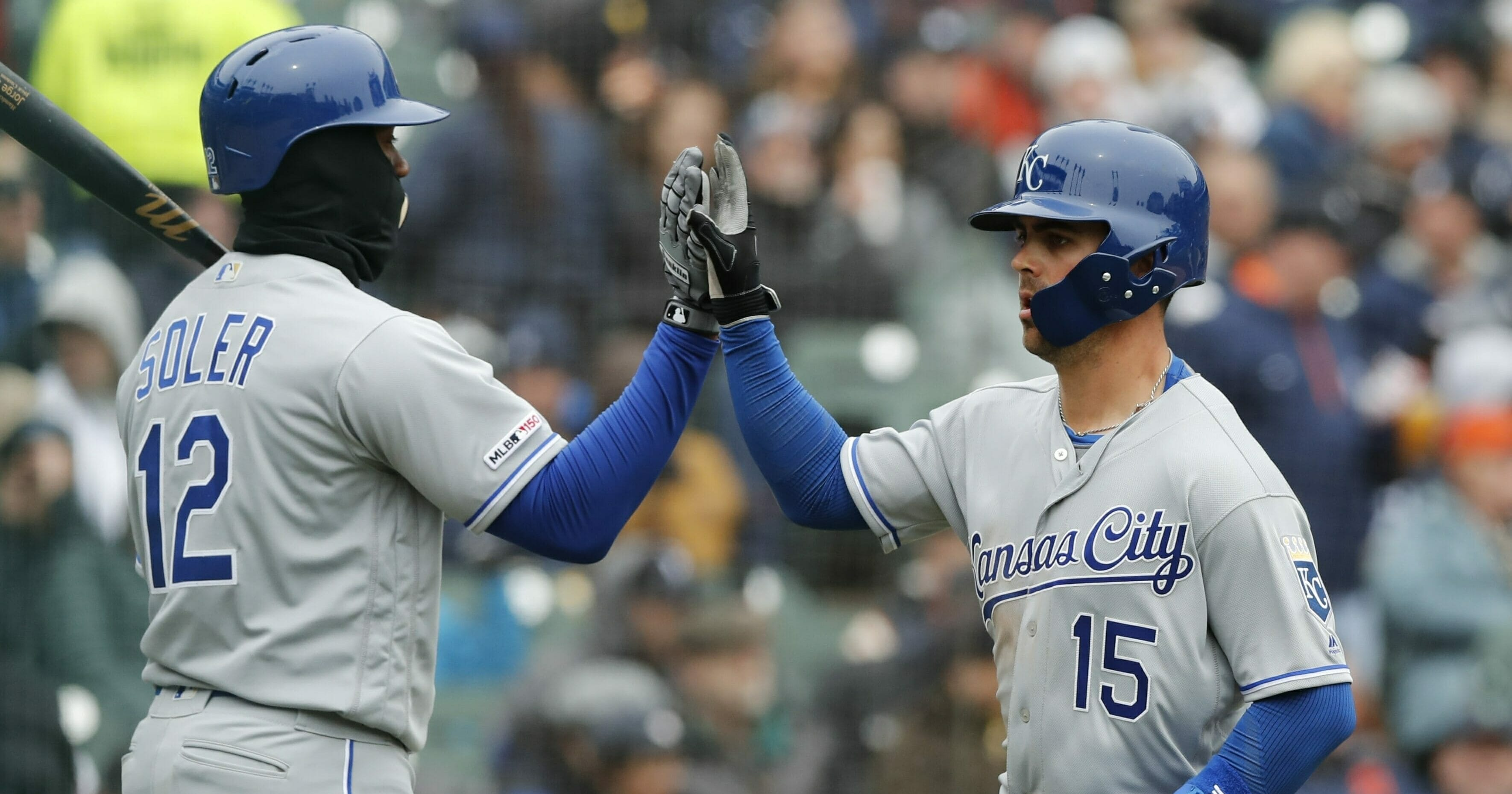 Kansas City Royals' Whit Merrifield scores on a sacrifice fly to left by teammate Alex Gordon during the fifth inning of a baseball game against the Detroit Tigers, Thursday, April 4, 2019, in Detroit.