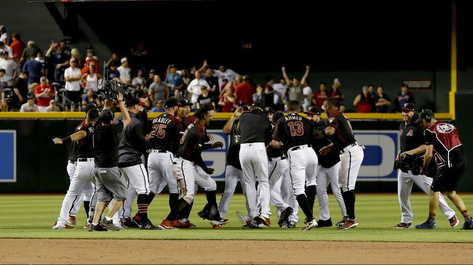 The Arizona Diamondbacks celebrate after defeating the Boston Red Sox in a baseball game, Saturday, April 6, 2019, in Phoenix.