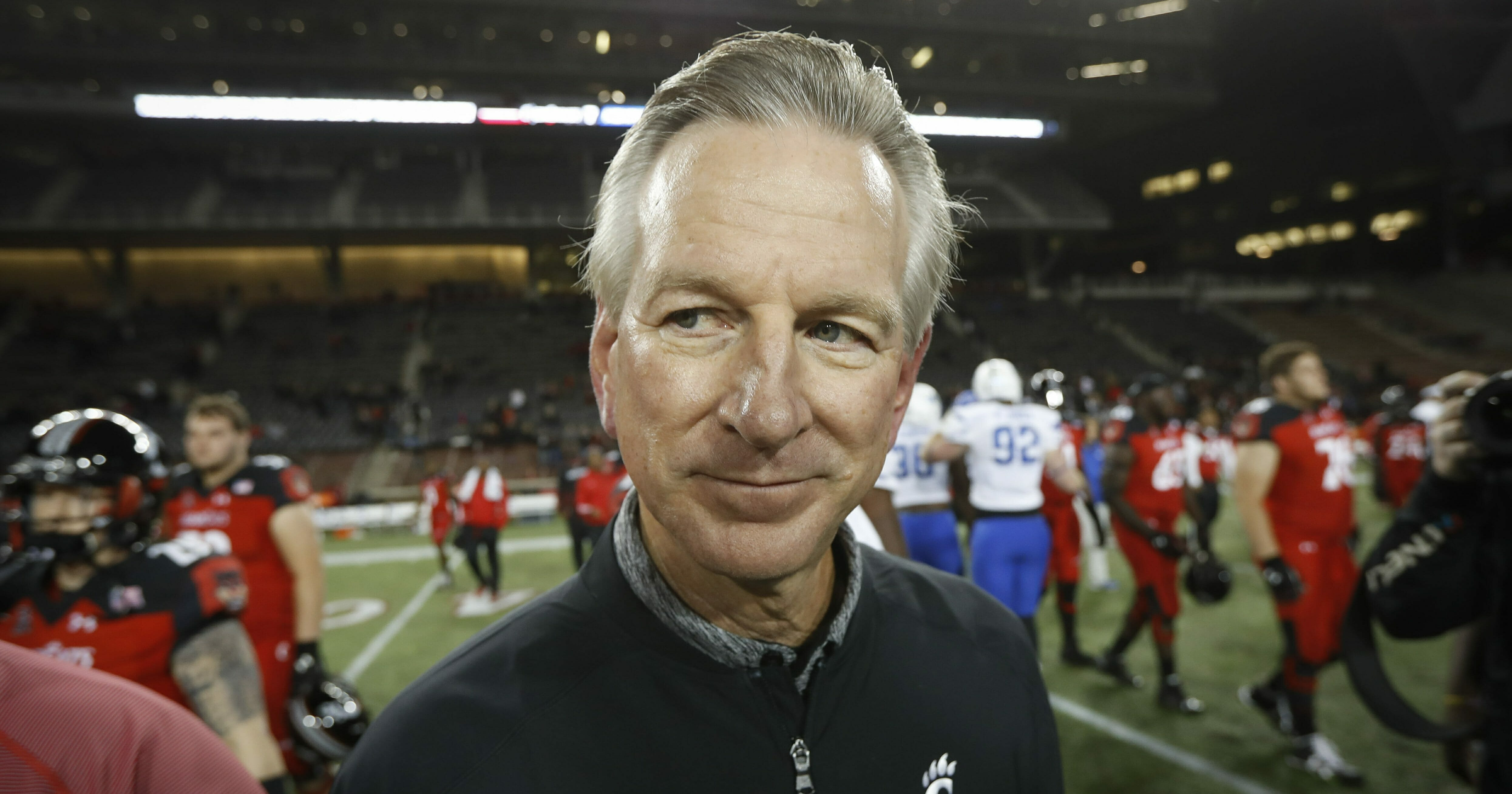 In this Nov. 18, 2016 file photo, Cincinnati coach Tommy Tuberville walks off the field after the team's NCAA college football game against Memphis in Cincinnati.
