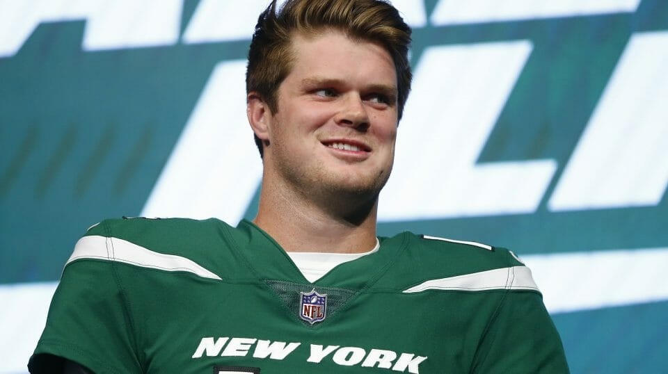 "New York Jets quarterback Sam Darnold models the team's new ""Gotham green"" uniform April 4, 2019, in New York."