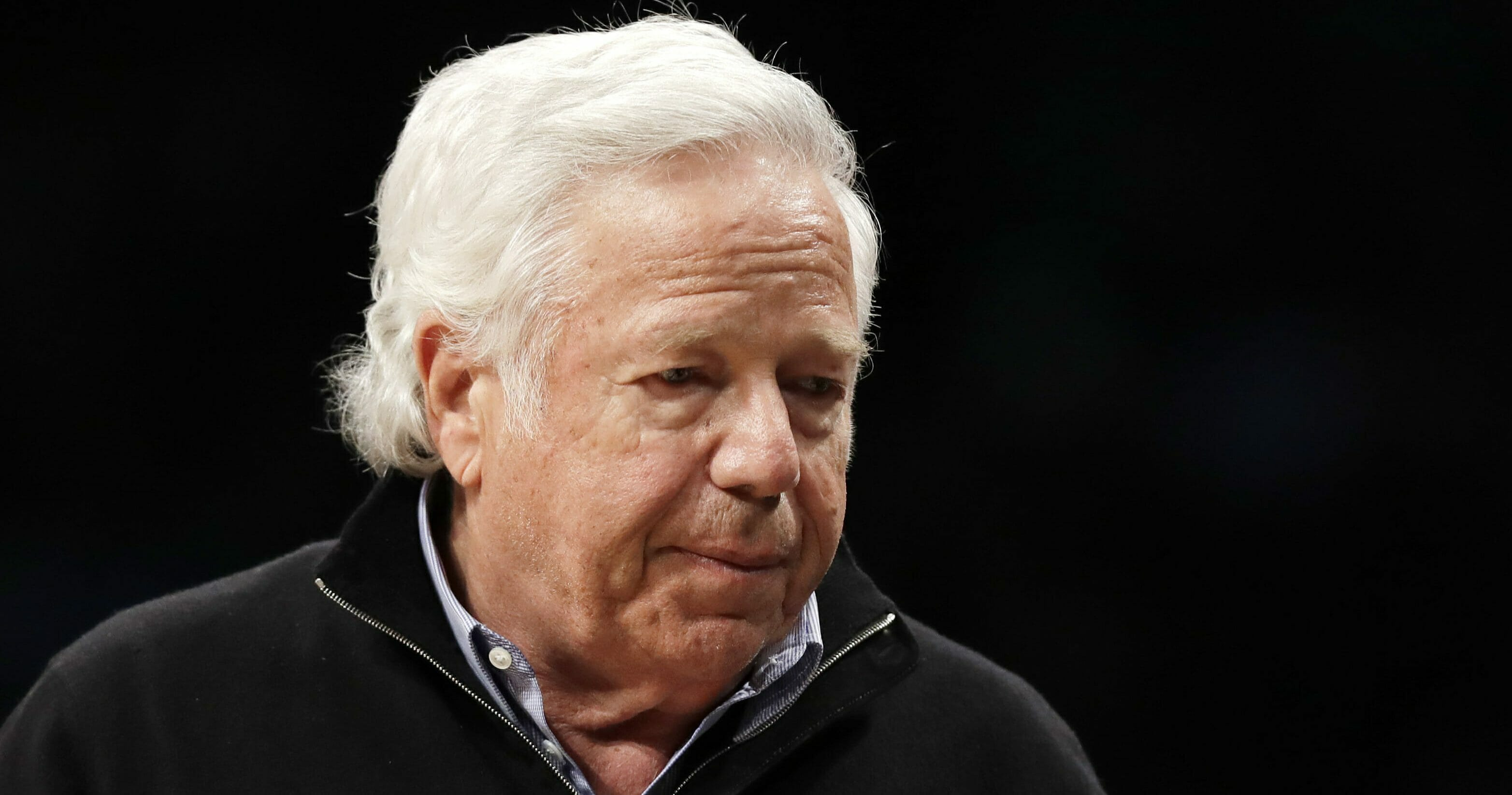 New England Patriots owner Robert Kraft leaves his seat during an NBA basketball game between the Brooklyn Nets and the Miami Heat on April 10, 2019, in New York.