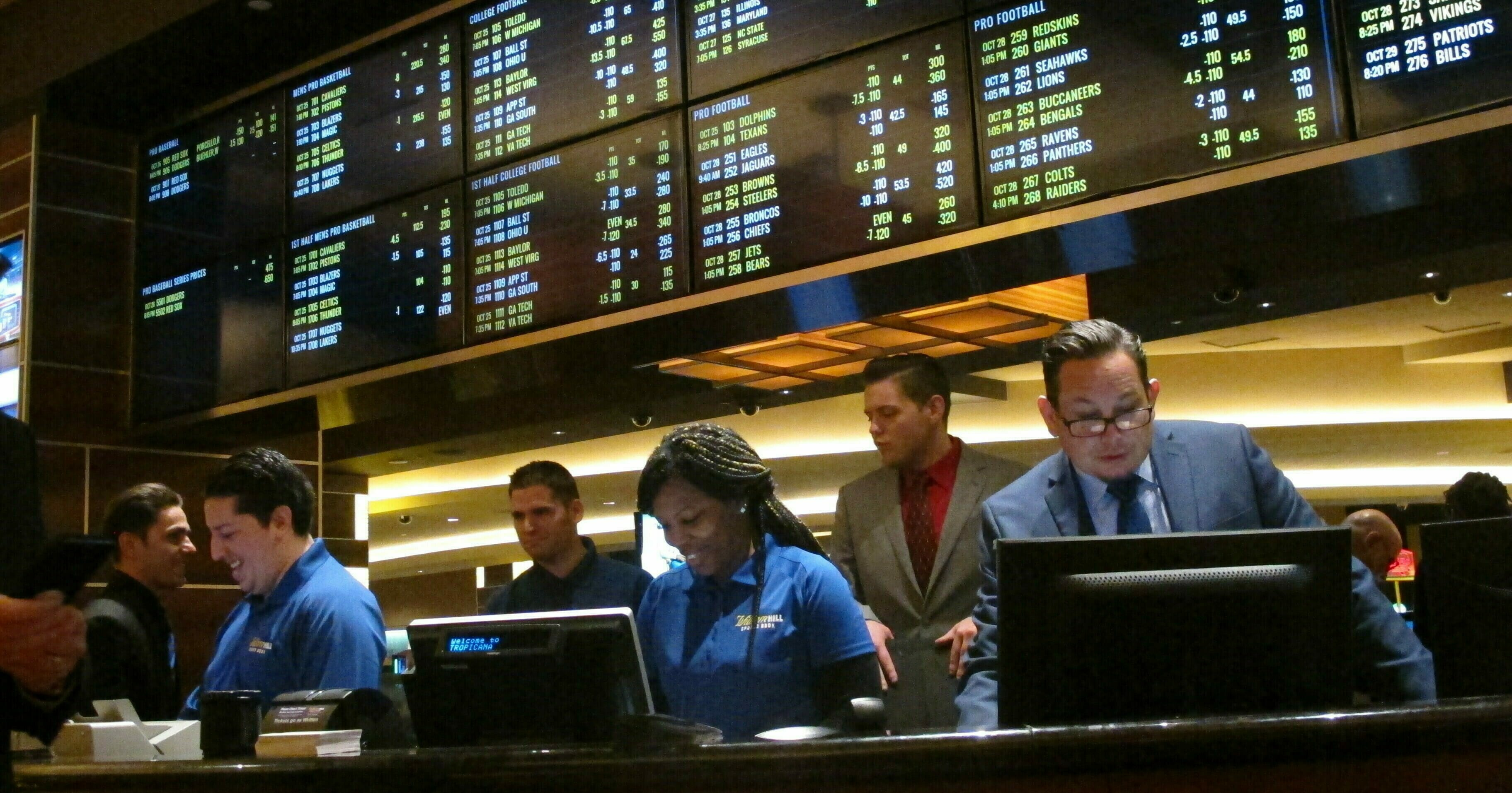 In this Oct. 25, 2018, file photo, employees prepare to take bets moments before the new sports book at the Tropicana casino in Atlantic City, N.J., opened.