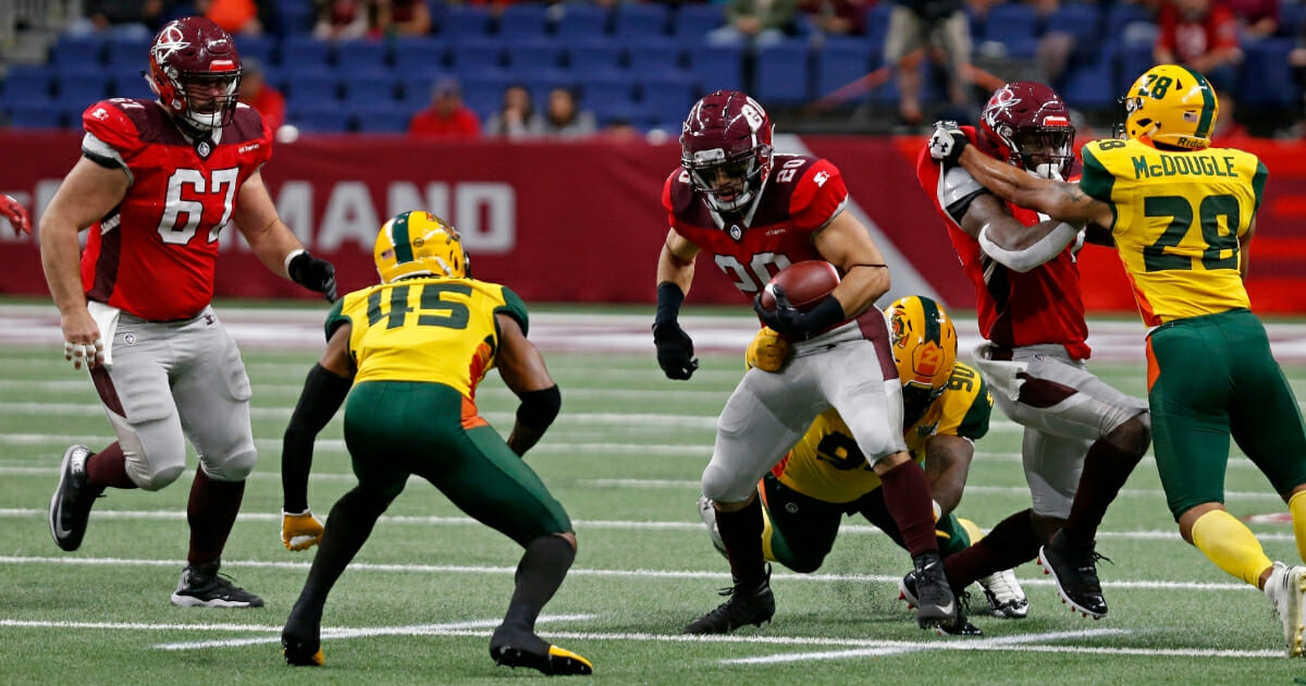 Kenneth Farrow II of the San Antonio Commanders tries to shake the tackle of Will Sutton III of the Arizona Hotshots during an Alliance of American Football game at the Alamodome in San Antonio on March 31, 2019.