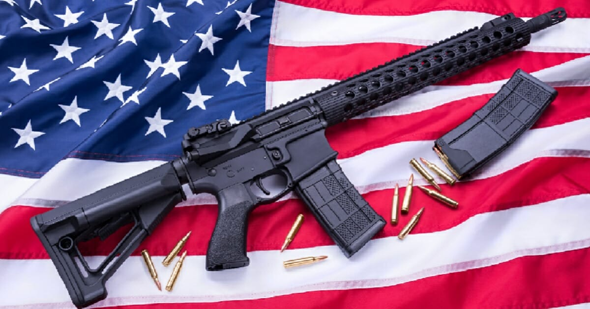 An AR-15 combined with an American flag is a powerful image of Second Amendment rights.