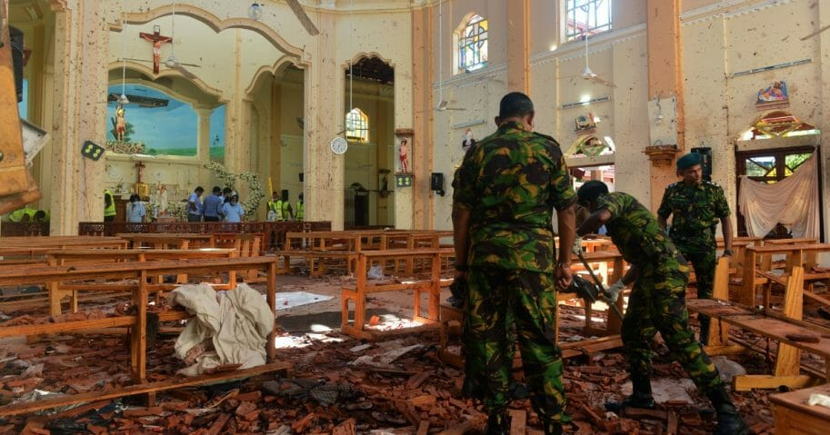 Security personnel inspect the interior of St. Sebastian's Church in Negombo on April 22, 2019, a day after the church was hit in series of bomb blasts targeting churches and luxury hotels in Sri Lanka.
